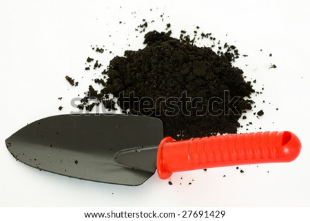 Stock photo: an image of a garden shovel and ground
