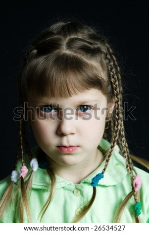 Stock photo: an image of a sad little girl with pigtails