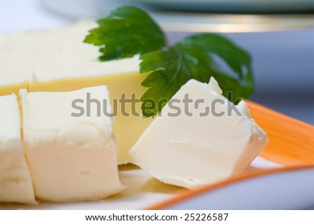 Stock photo: an image of blocks of butter and parsley closeup