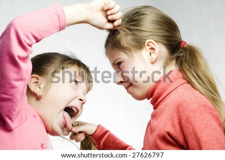 Stock photo: an image of two sisters fighting - stock photo