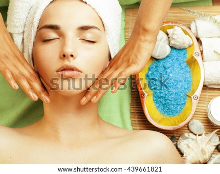 stock photo attractive lady getting spa treatment in salon, close up asian hands on face - stock photo