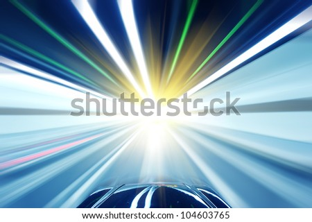 Stock Photo: Car driving fast down interior tunnel - stock photo