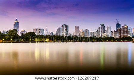 Stock Photo: City downtown at night with reflection of skyline