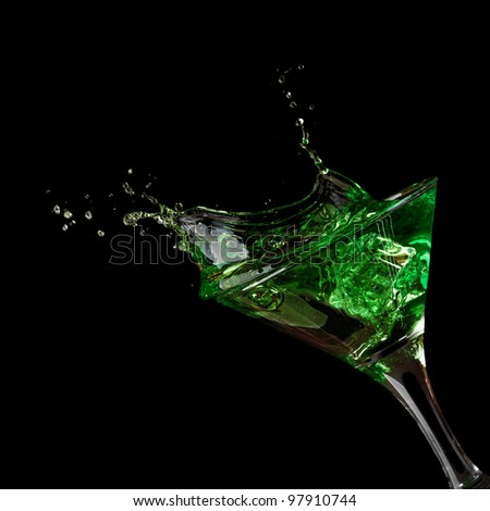 Stock Photo: green martini cocktail splashing into glass