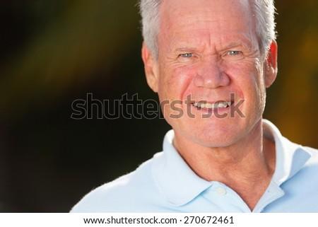 Stock photo handsome senior man posing outdoors - stock photo