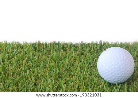 Stock Photo - isolated golf ball on green grass over white background