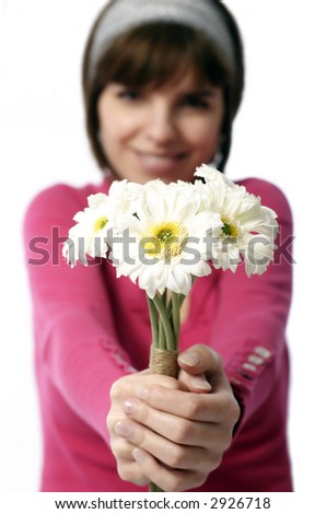 Stock photo of a pretty young  woman offering flowers - stock photo
