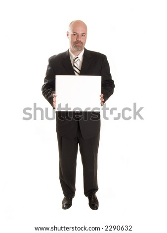 Stock photo of a well dressed businessman holding a blank sign, ready for your copy. - stock photo