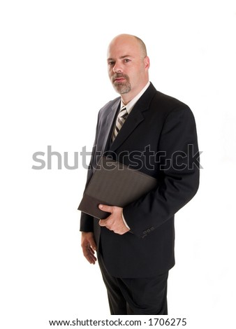 Stock photo of a well dressed businessman holding a notebook. - stock photo