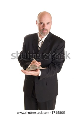Stock photo of a well dressed businessman making notes on a clipboard, isolated on white. - stock photo