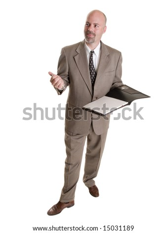 Stock photo of a well dressed businessman taking notes in a notebook.