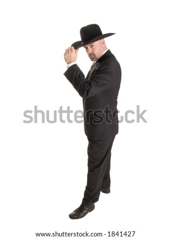 Stock photo of a well dressed businessman tipping his cowboy hat in greeting.  Full length, isolated on white. - stock photo