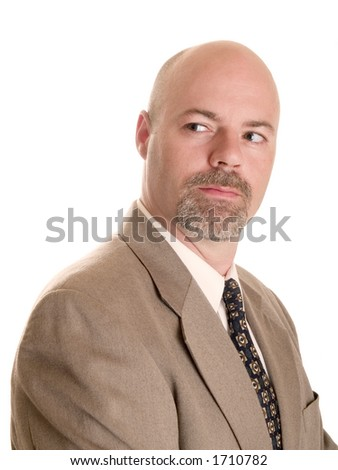 Stock photo of a well dressed confident businessman looking over his shoulder, isolated on white. - stock photo