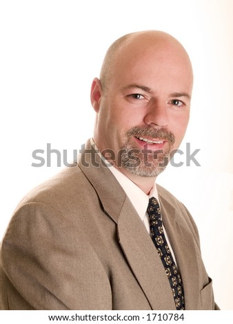 Stock photo of a well dressed, smiling, friendly businessman looking directly at the camera, isolated on white. - stock photo