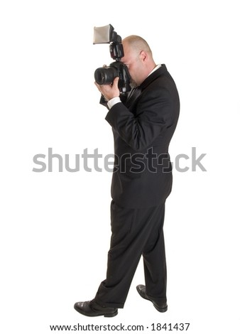 Stock photo of a well dressed wedding photographer with a camera.  Full length, isolated on white.
