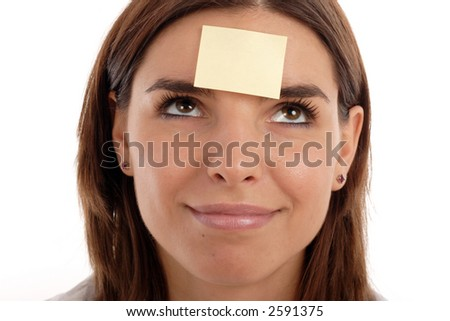 Stock photo of a young pretty woman with a post-it note on her forehead