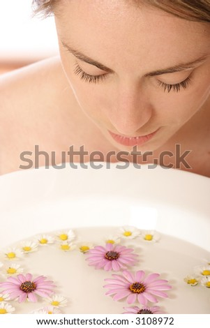 Stock photo of a young woman, beauty concept, facial wash