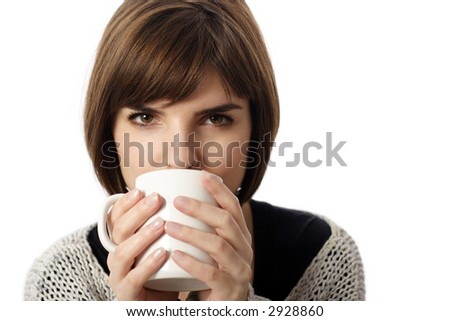 Stock photo of a young woman drinking coffee or tea