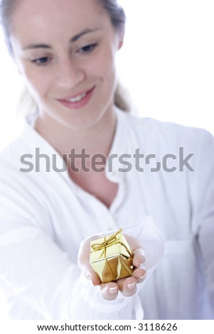 Stock photo of a young woman holding a small gift