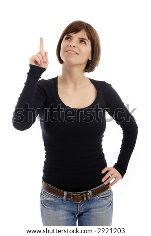 Stock photo of a young woman pointing up