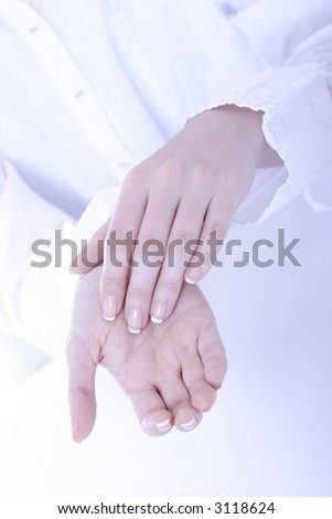Stock photo of a young woman's hands, applying cream on her hands