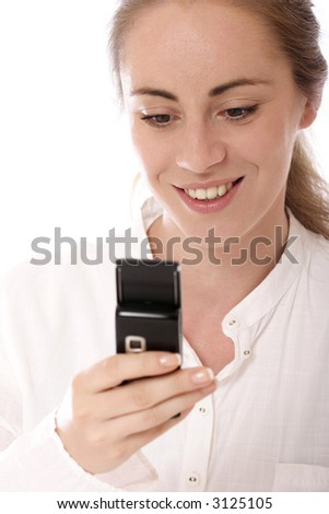 Stock photo of a young woman using mobile phone text messaging
