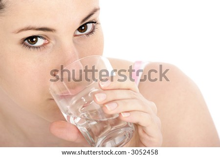 Stock photo of a young woman with glass of water