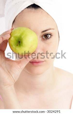 Stock photo of a young woman with green apple