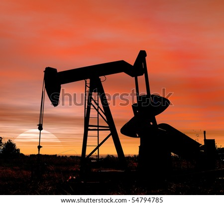 Stock photo of an oil pumper at sunset in near square format - stock photo