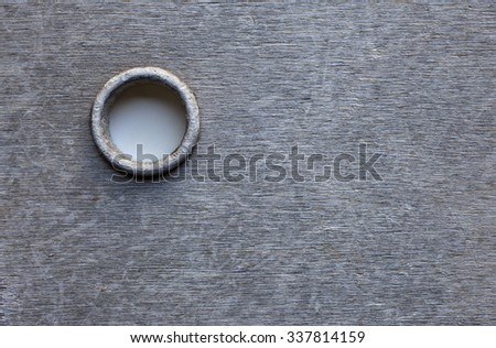 Stock photo of weathered gray plywood plate with a whole. - stock photo