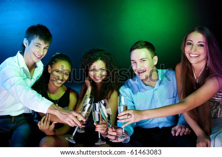 Stock Photo: People  holding the glasses of champagne making a toast - stock photo
