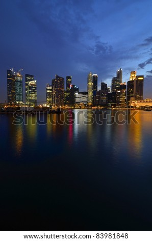 Stock Photo: Singapore skyline and river at blue hour