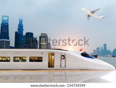 Stock Photo: very high-speed train go through the shanghai financial center . - stock photo