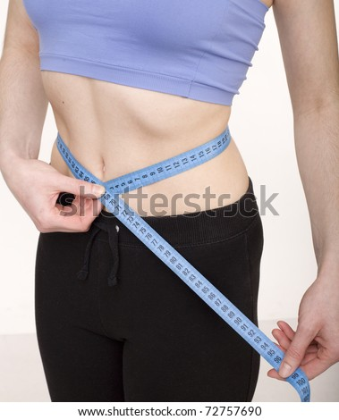 stock photo woman measuring her waistline, middle part - stock photo