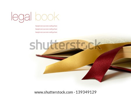Stock photograph of legal concept, old book with legal ribbon ties on a white surface. Copy space. - stock photo