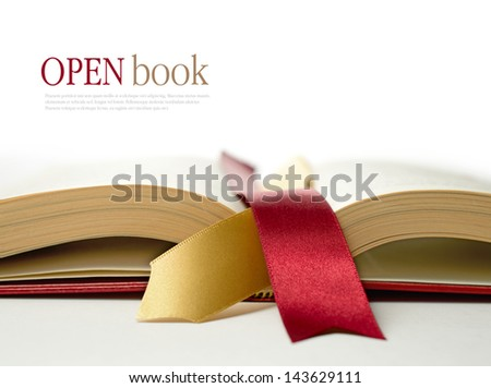 Stock photograph of legal concept, open old book with legal ribbon ties on a white surface. Copy space. - stock photo