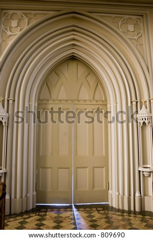 Stock photograph of the interior doorway at a small catholic basilica. - stock photo