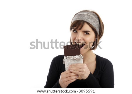 Stock Photography of pretty young woman eating chocolate