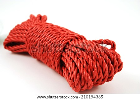 stock picture of a coil and loop of red rope - stock photo