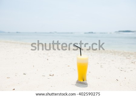 Stock picture of fresh pineapple juice on the beach - stock photo