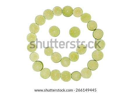 Stock picture of sliced limes forming a smiley face - stock photo