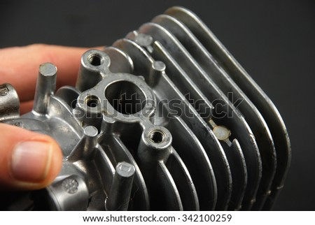 Stock pictures of a small gas engine and a carburetor - stock photo