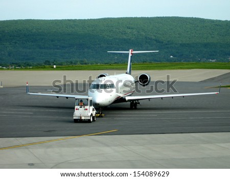 stock pictures of airplanes on the ground in an airport  - stock photo