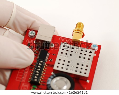 stock pictures of an electronics board with a radiofrequency connector - stock photo