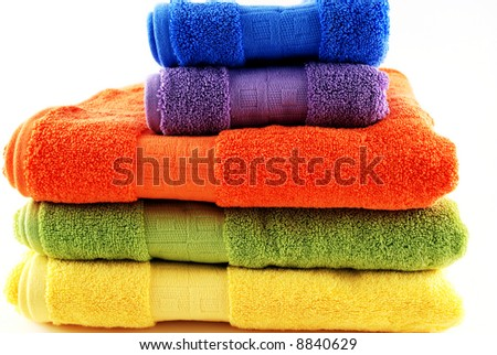 stock pictures of colorful bath towels stacked - stock photo