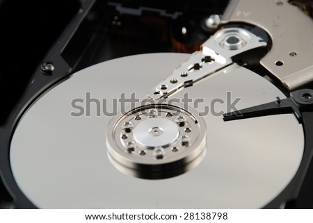 Stock pictures of the interior of a compute hard drive - stock photo