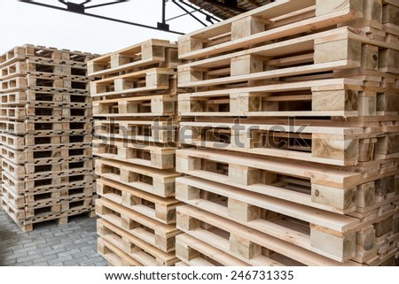 Stock Piles of wooden pallets in a yard - stock photo