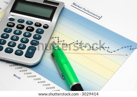 Stock Report with Calculator and Green Pen - stock photo