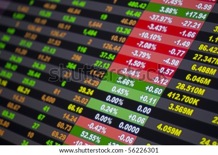 Stock ticker board at the stock exchange, shallow depth of field - stock photo