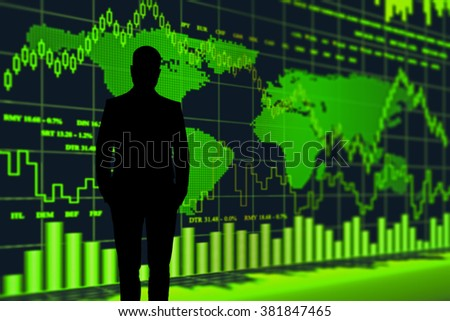 stockbroker at the screen with quotes and  world map - stock photo